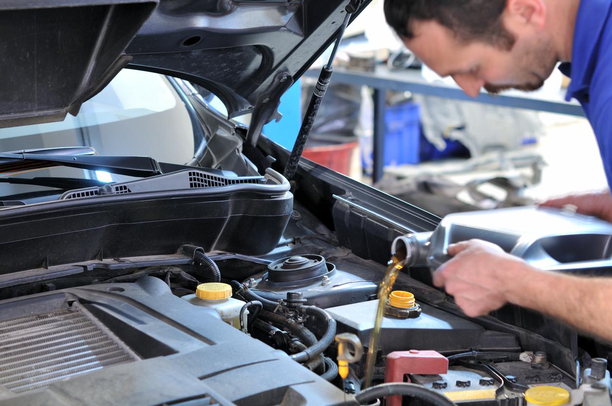 Mechanic Replacing Oil