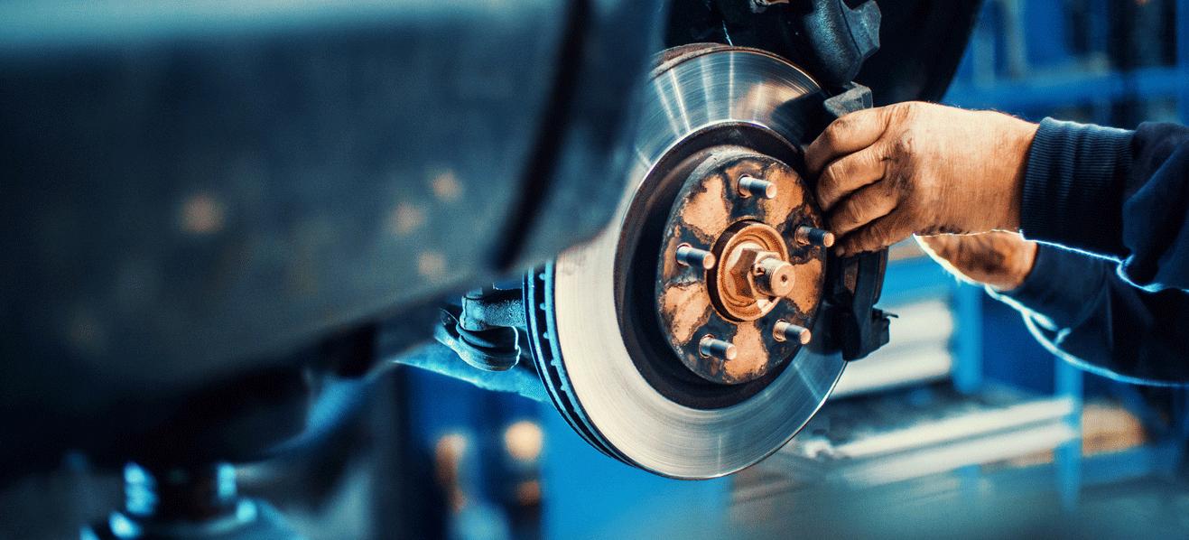 Car Repair Person Replacing Brakes on Vehicle Glendale, WI